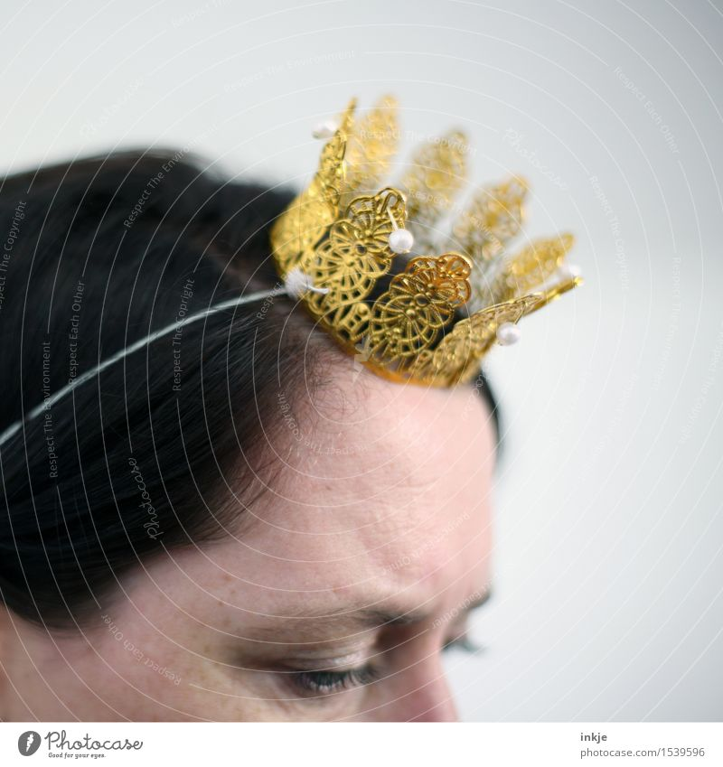 Coronet left Lifestyle Leisure and hobbies Carnival Woman Adults Head Face 1 Human being 30 - 45 years Crown Costume Elastic band Gold Plastic Kitsch Small