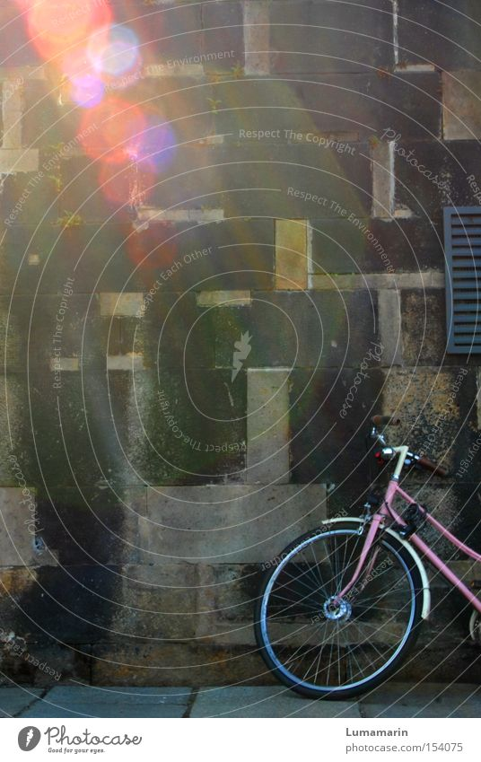 travel dreams Wall (barrier) Wall (building) Parking area Wait Bicycle Pink Light Beam of light Lens flare Multicoloured Beautiful Longing Dream Wanderlust