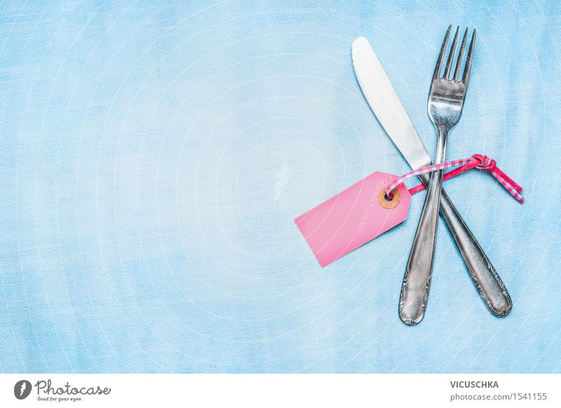 Cutlery set with empty place card on light blue background Nutrition Banquet Style Design Living or residing Decoration Table Event Set meal
