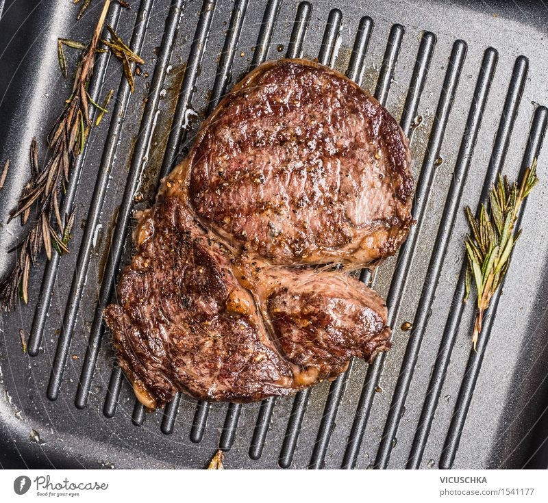 Grilled Steak Striploin on Grill Iron Pan Food Meat Herbs and spices Cooking oil Nutrition Lunch Dinner Banquet Business lunch Style Kitchen Restaurant