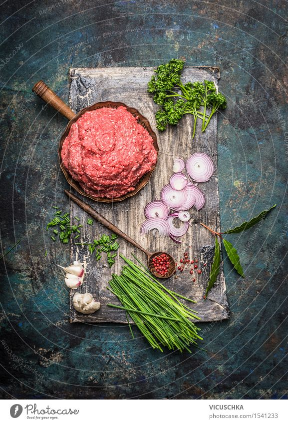 Minced meat in a pan with cooking ingredients Food Meat Herbs and spices Nutrition Lunch Dinner Buffet Brunch Organic produce Pan Spoon Style Table Kitchen