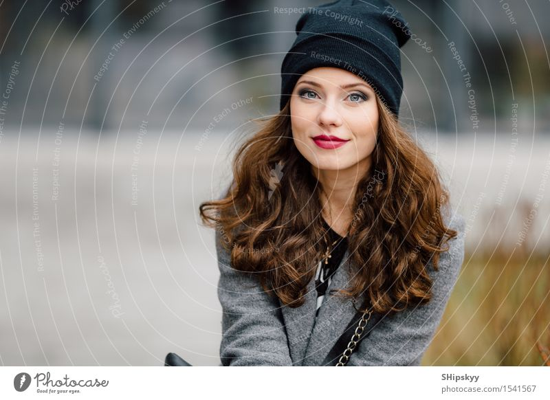 Young woman sitting on the street Lifestyle Elegant Style Joy Happy Beautiful Face Leisure and hobbies Camera Human being Girl Woman Adults Town Street Fashion
