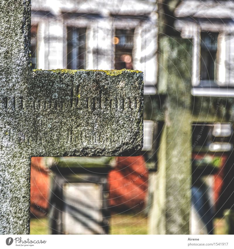what remains Sculpture Town Deserted Cemetery Tombstone Epitaph Facade Stone Sign Characters Crucifix Sleep Sadness Old Gray Red Humanity To console Calm Belief