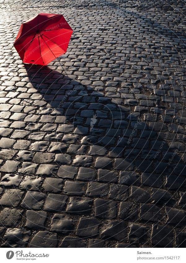 URBAN STILL LIFE Traffic infrastructure Street Lanes & trails Red Umbrella Cobblestones City life Still Life Colour photo Multicoloured Exterior shot Detail