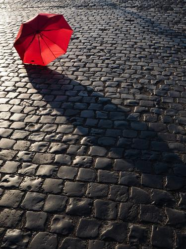 URBAN STILL LIFE Traffic infrastructure Street Lanes & trails Red Umbrella Cobblestones City life Still Life Colour photo Multicoloured Exterior shot Detail