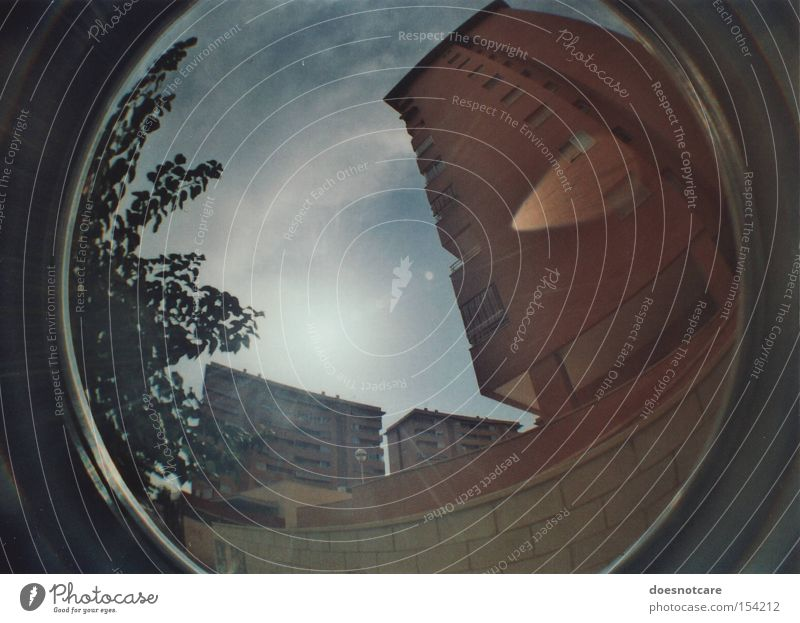 tilting. House (Residential Structure) Alicante Spain High-rise Architecture Facade Concrete Threat Tall Patch of light Distorted Tree Fisheye Colour photo