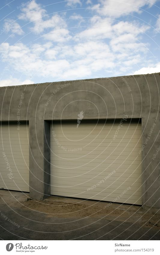 Architecture Closed Motor vehicle Sporting event Blue sky Competition Garage Warm light Abstract Garage door