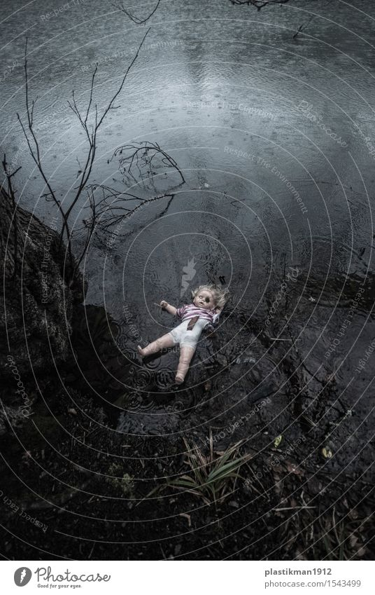 a doll Girl Body Water Drops of water Rain Tree Leaf Lake Toys Doll Fear Dramatic Childhood memory Old Sadness Loneliness Dark Reflection Float in the water