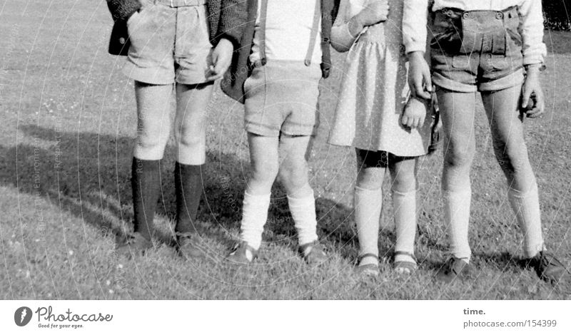 Rattle Gang 1965 Summer Child Legs Meadow Clothing Going Walking 8 Shorts Sock Knock-kneed 4 Lawn Leather shorts Row Black & white photo Exterior shot Detail