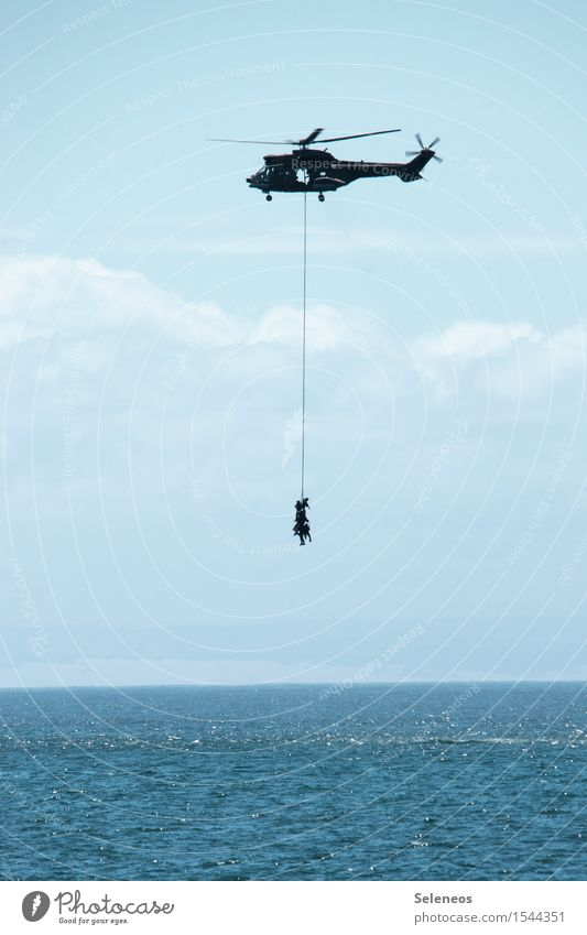 hang out Human being Sky Clouds Horizon Ocean Aviation Helicopter Maritime Rescue Colour photo Exterior shot Copy Space bottom