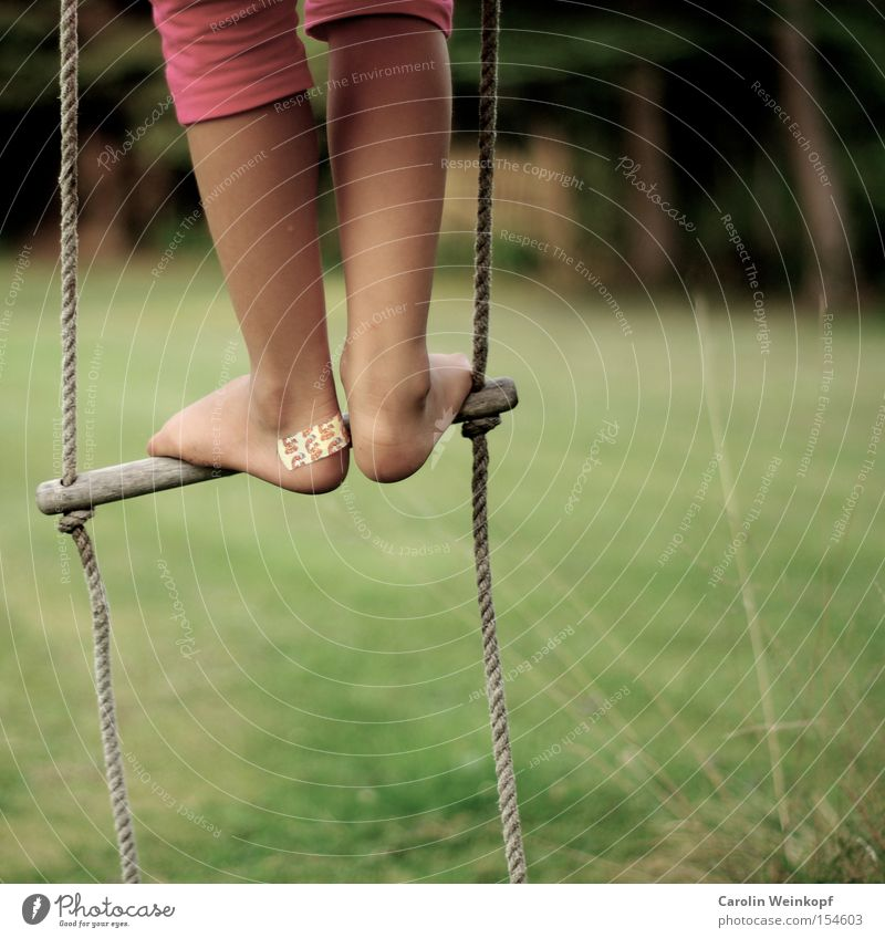 Back then. Joy Leisure and hobbies Playing Freedom Garden Climbing Playground Child Legs Feet Meadow Clothing Pants To swing Romp Rope ladder Wound Colour photo