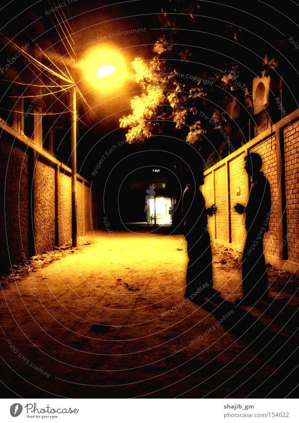 Standing under the sun Street Lantern Friendship Night Sepia Wall (building) Black Yellow Tree