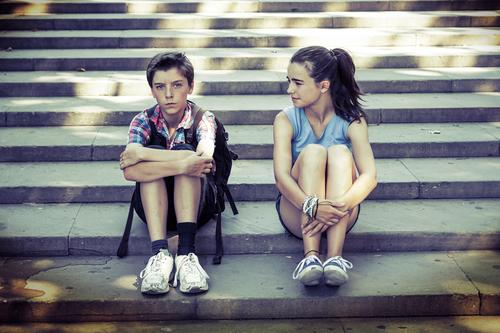 Siblings sit on the steps, one is angry Lifestyle Vacation & Travel Tourism Trip Sightseeing Summer vacation Human being Masculine Feminine Young woman