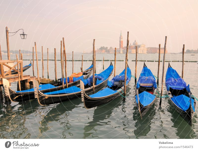 Gondolas and Church of San Giogio Maggiore in Venice Tourism City trip Ocean Island Italy Town Outskirts Boating trip Watercraft Blue Brown Yellow Green