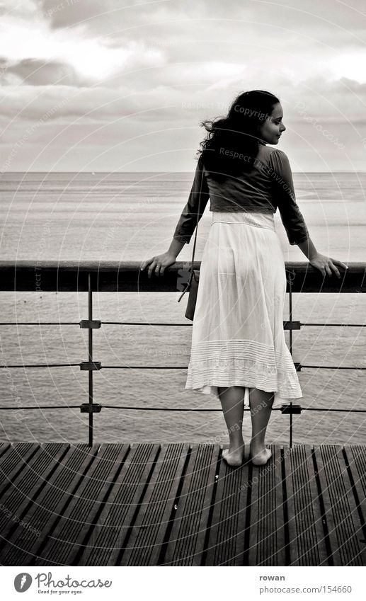 girl by the sea Woman Promenade Beach Lake Ocean Looking Vantage point Calm Cruise Watercraft Deck Barefoot Coast Black & white photo look of the shoulder