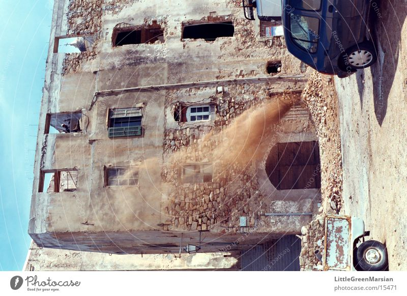 safety?!? Working man Corsica Building rubble Wheelbarrow Architecture old house dust[cloud] Wind