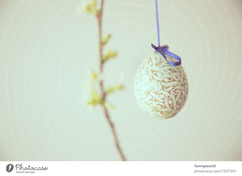 ornamental egg Easter Hang Egg Easter egg Spring Ornament Self-made Bow Blue Twig Bud Colour photo Interior shot Deserted Copy Space left Copy Space right Day