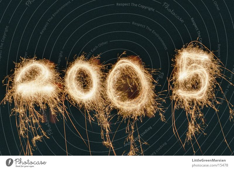 Happy New Year! New Year's Eve Sparkler Spray Long exposure Night Tracer path Digits and numbers 2004 - 2005 Blaze