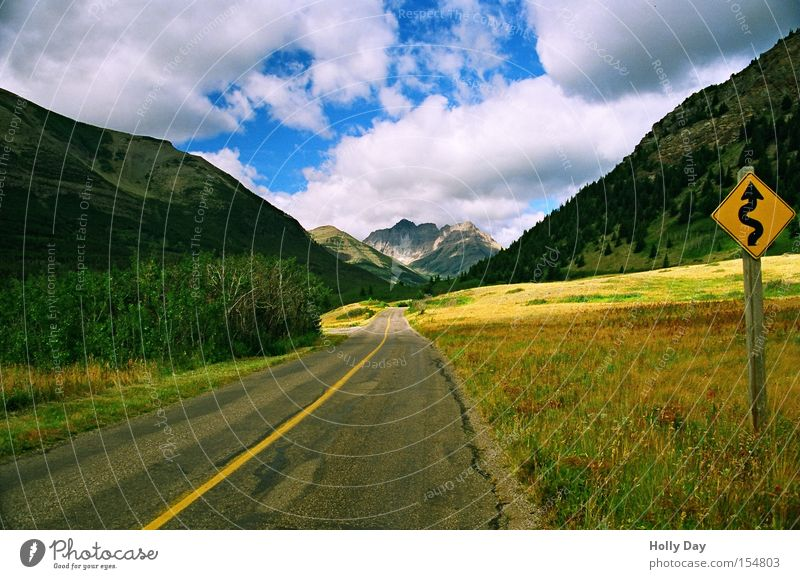 Clouds Street Meadow Mountain Light Lanes & trails Signs and labeling Perspective Traffic infrastructure Canada Curve Street sign Alberta Rocky Mountains
