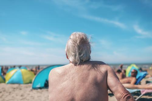 Elderly man enjoying himself at the beach Lifestyle Relaxation Vacation & Travel Summer Beach Retirement Man Adults Coast Old Hot Behind holiday seaside senior