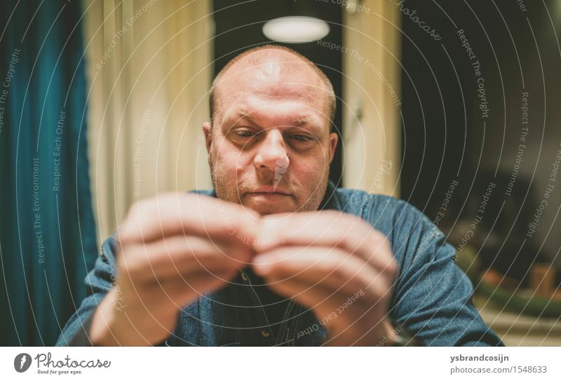 Serious Man Looking at his Fingertips Touching Face Work and employment Human being Adults Hand Fingers Think Sit Considerate balding concentrating Meditative