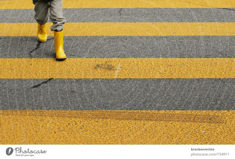 Child Yellow Street Boy (child) Safety Going Transport Intersection Traffic infrastructure Student Boots Profession Education Pedestrian Zebra crossing Traverse