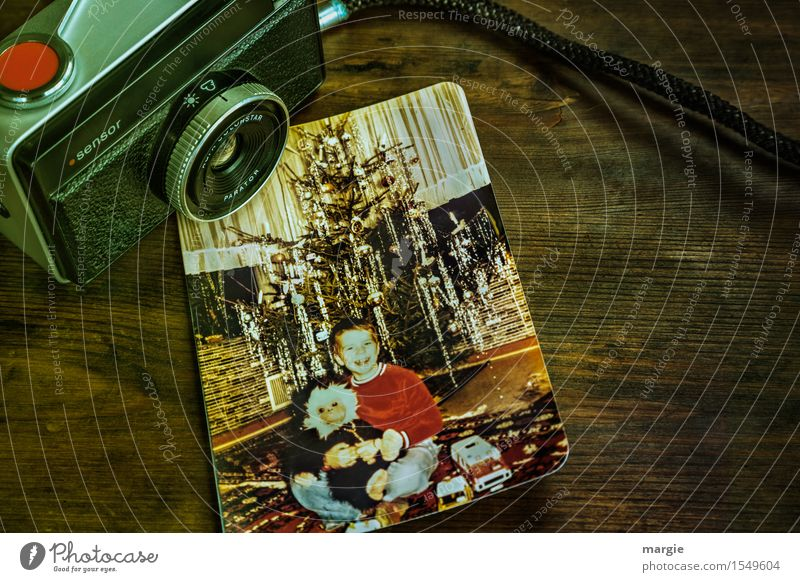 Nostalgia - Christmas Joy- An old analogue camera with a photo of a little boy sitting in front of a Christmas tree Feasts & Celebrations Christmas & Advent