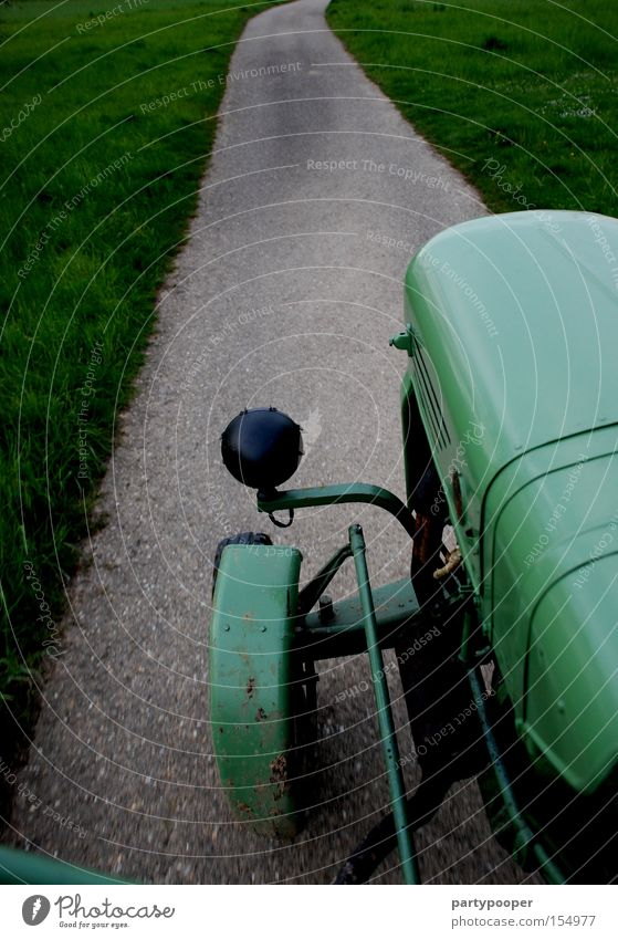 Favourite tractor Green Street Lanes & trails Tractor Tractor wheel Vintage car Asphalt Speed Engines Tire Gray Grass Industry Motorsports driver's perspective