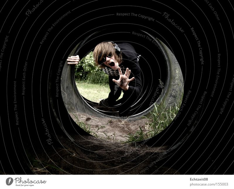 Spiral Collapse. Tunnel vision Shock Eyeglasses Music Headphones Perturbed Earth Sand Obscure Young man Scream Hand Tire Youth (Young adults)