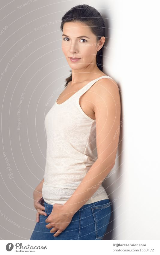 Pretty Young woman smiling at the camera Body Skin Face Feminine Woman Adults 1 Human being 30 - 45 years Shirt Jeans Brunette Old Fitness Stand Thin at camera