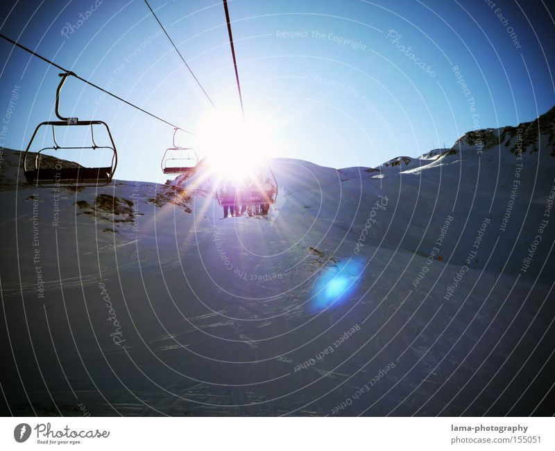 Vacation & Travel Sun Winter Snow Mountain Snowscape Winter sports Snowcapped peak Ski resort Ski lift Winter vacation Ski run Vignetting Lens flare Chair lift