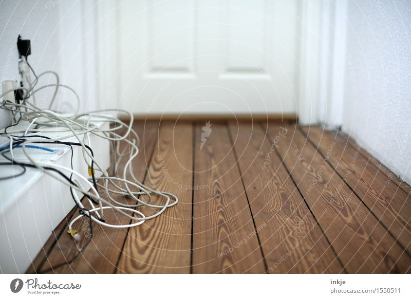 Cable spaghetti in the hallway Living or residing Wooden floor Wooden door Hallway Terminal connector Telecommunications Deserted Chaos Untidy Muddled