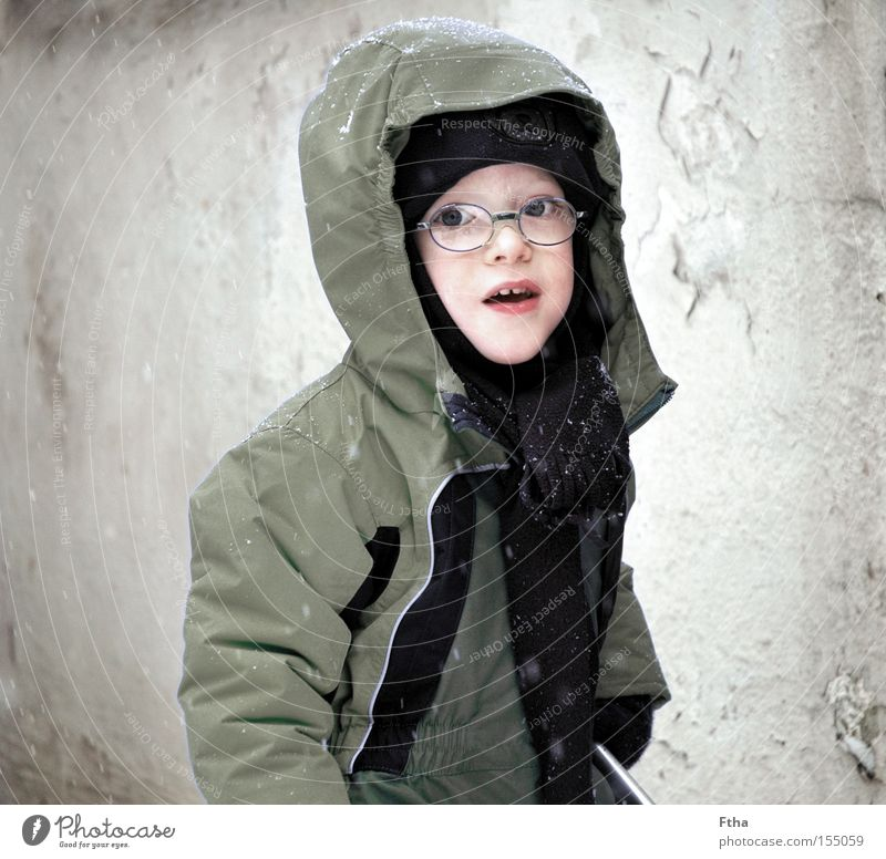 frost child Snow Snowfall Child Boy (child) Portrait photograph Sepia White Winter Eyeglasses Cold Frost Freeze Jacket Scarf Toddler Captured Looking Curiosity