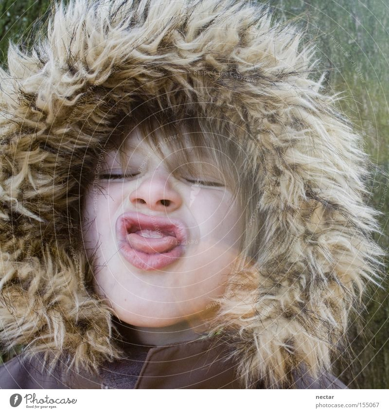 Child Joy Playing Boy (child) Infancy Face Kindergarten Tongue Tongue Clown Hooded (clothing) Grimace Absurdity Humor