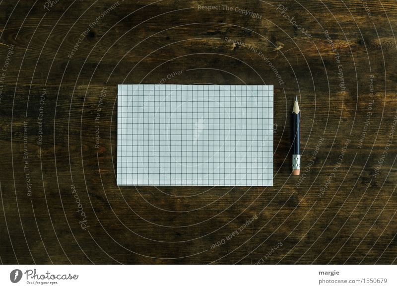 A checkered paper sheet and a pencil on an old desk Study Work and employment Office work Workplace Media industry Advertising Industry Financial Industry