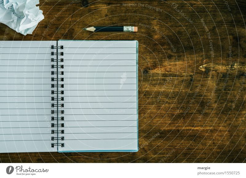 Lined notebook with spiral, pencil and a crumpled piece of paper on an old wooden table Education School Study Work and employment Profession Office work