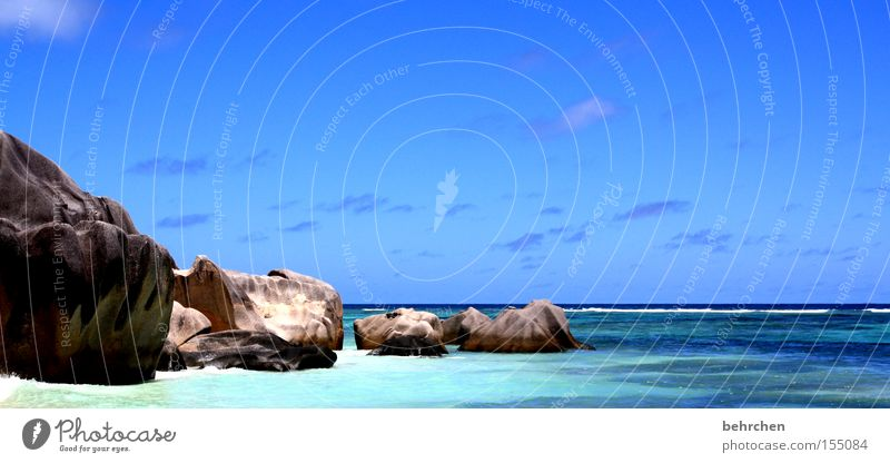 paradise Seychelles Paradise Dream island Water Ocean Beach Blue Rock Stone Vacation & Travel Honeymoon To enjoy Clouds Sky Coast fantastically beautiful