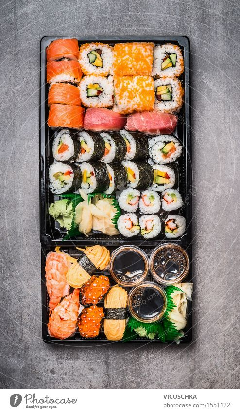 Sushi Menu in black packing box Food Nutrition Buffet Brunch Asian Food Style Design Healthy Eating Restaurant various japanese Dish Japan Food photograph Fish