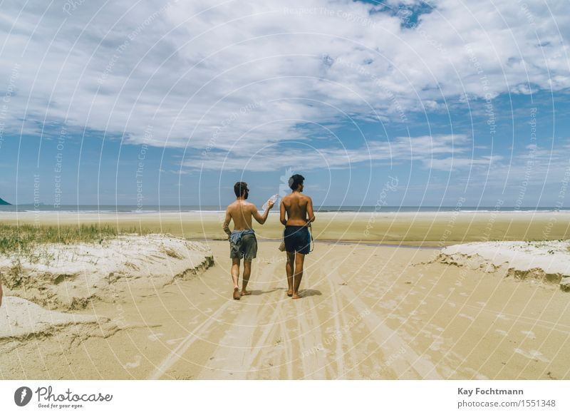 Human being Sky Vacation & Travel Youth (Young adults) Summer Sun Ocean Young man Landscape Clouds Joy Far-off places Beach 18 - 30 years Adults Warmth