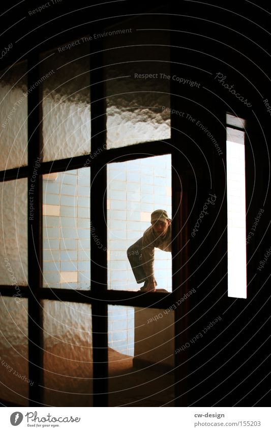 ALWAYS ON THE GO Glass Window pane Slice Door Human being Staircase (Hallway) Tile Old Loneliness Posture Climbing Acrobat Leisure and hobbies Derelict Man