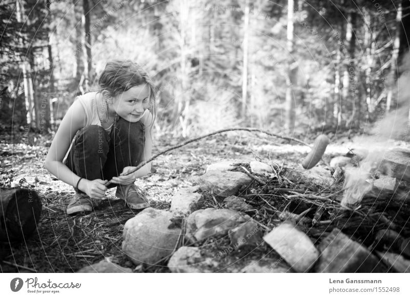 Mädchen grillt sich über einem Lagerfeuer ein Würstchen Human being Child Nature Summer Tree Girl Forest Spring Meadow Feminine Wood Food Stone Earth Infancy