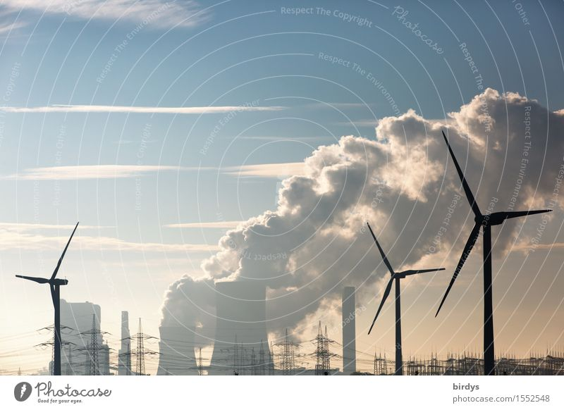 Wind turbines in front of a lignite-fired power plant Energy industry Renewable energy co2 Wind energy plant Coal power station Sky Clouds Climate change Threat