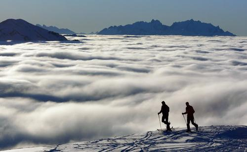 above the clouds Clouds Mountain cloud Cloud field Band of cloud Wisp of cloud Cloud cover Winter Ski tour Skiing Skis Mount Säntis Forest of Bregenz Tourism