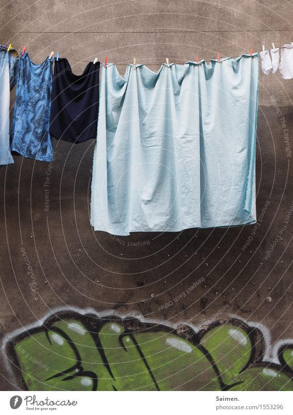 Street art meets everyday life Clothing T-shirt Stockings Underwear Authentic Graffiti Laundry Clothesline Hang Clothes peg Colour Wall (building) Facade Sheet