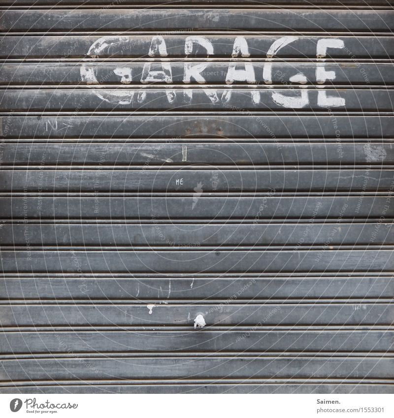 valuable label Facade Old Garage Garage door Doorknob Disk Lettering Letters (alphabet) Characters Structures and shapes Line Colour photo Subdued colour