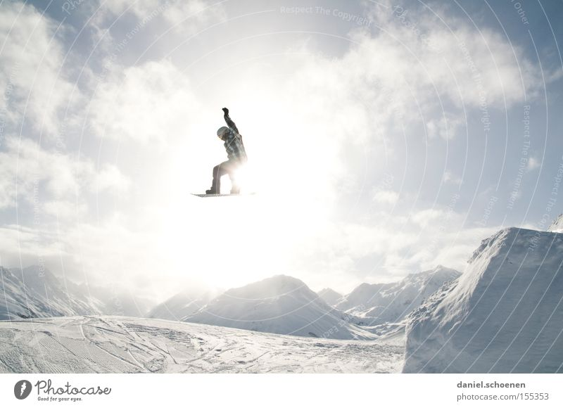in the light (part 1) Winter Winter sports Joy Clouds Mountain Light Snow Action Snowboarder Snowboarding Tall far Ski jump Fun park Winter sun Back-light