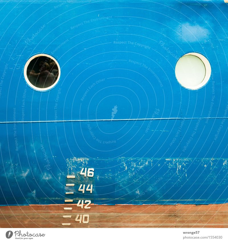 Blue side of a ship with 2 portholes and the draught indicator Navigation Container ship Watercraft Porthole Old Brown White Ship's side Draft