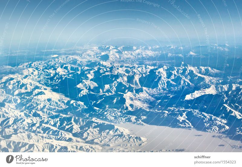 So peaceful from above Environment Nature Landscape Sky Winter Climate Climate change Beautiful weather Rock Mountain Peak Snowcapped peak