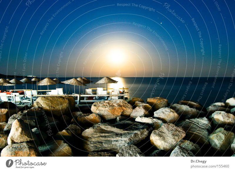 Moonlight in Assos Night sky Blue Stone Light (Natural Phenomenon) Ocean Evening Umbrella Coast Dark Landscape Beach Celestial bodies and the universe
