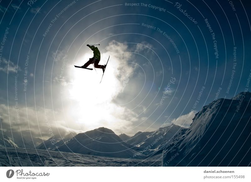 in the light (part 2) Winter Winter sports Joy Clouds Mountain Light Snow Action Skiing Back-light Sunbeam Silhouette Tall Extreme Extreme sports Jump Flying